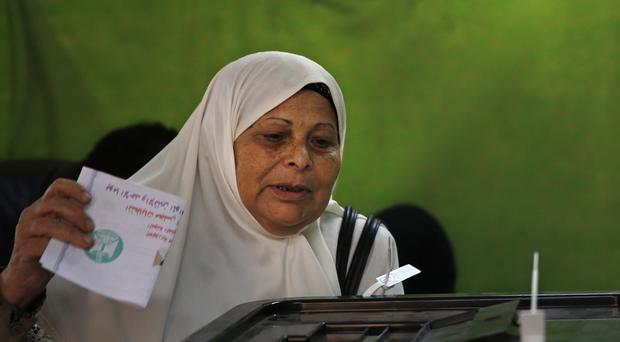 An Egyptian woman casts her ballot (AP)