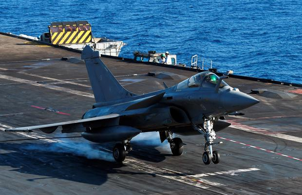 A French Rafale fighter jet lands on the French aircraft carrier Charles de Gaulle yesterday in the eastern Mediterranean Sea