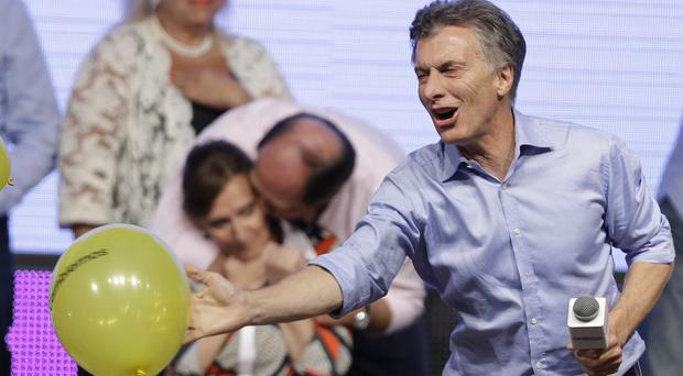 Mauricio Macri celebrates his election victory with supporters at his campaign headquarters in Buenos Aires (AP)