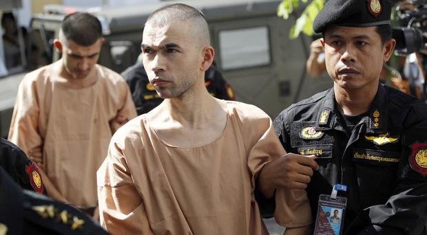 The suspects in Erawan Shrine blast, Bilal Mohammad, front, and Mieraili Yusufu, arrive at a military court in Bangkok (AP)