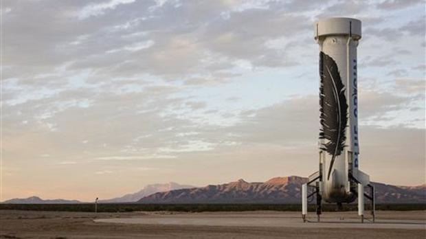 An unmanned Blue Origin booster rocket sits after landing in Van Horn, west Texas (Blue Origin via AP)