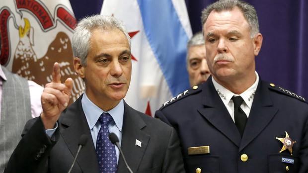 Chicago Mayor Rahm Emanuel, left, and Police Superintendent Garry McCarthy announce murder charges against Jason Van Dyke (AP)