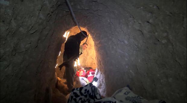 Kurdish security forces inspect a tunnel complex under the city of Sinjar, northern Iraq, which was used by Islamic State fighters (AP)