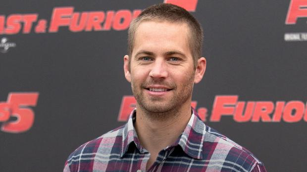 Paul Walker poses during the photo call for Fast And Furious 5 in Rome in 2011 (AP)