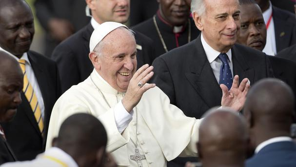 Pope Francis on his arrival at the airport in Nairobi (AP)