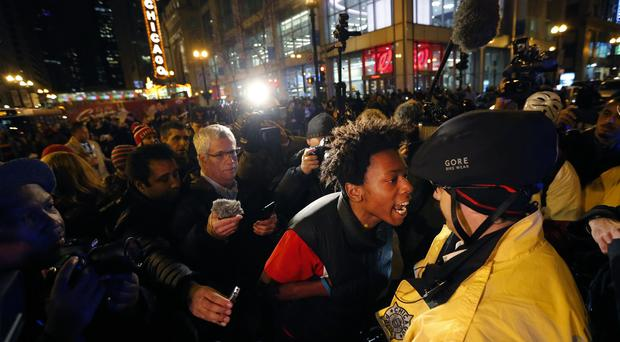 Lamon Reccord yells at a Chicago police officer during a rally over the death of Laquan McDonald (AP)