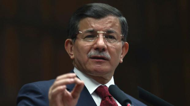 Turkish prime minister Ahmet Davutoglu has sought to reduce tensions with Moscow (AP)