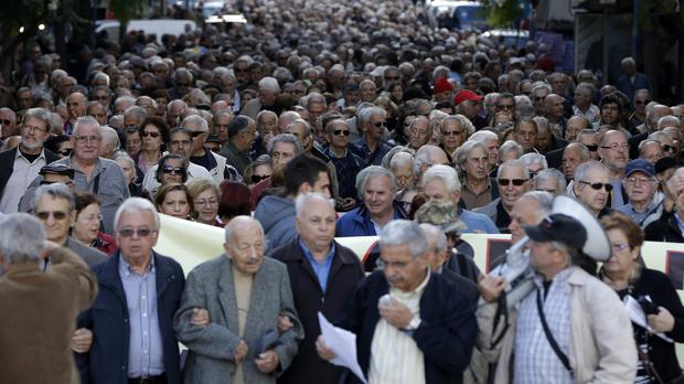 Pensioners take part in an anti-austerity protest in Athens (AP)