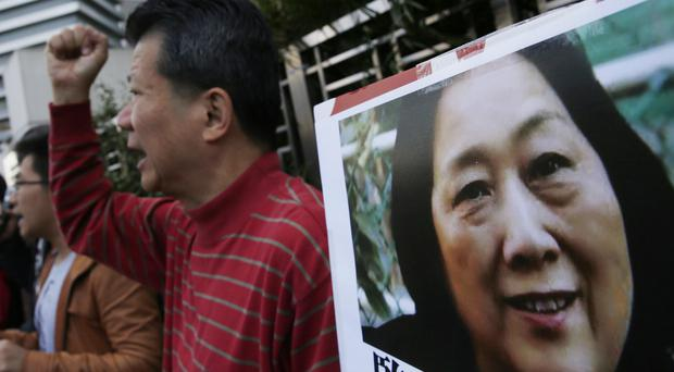 Anti-Beijing protesters hold picture of veteran Chinese journalist Gao Yu during a rally in Hong Kong (AP)
