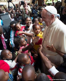 Pope Francis is greeted during a visit to the Kangemi slum in Nairobi yesterday