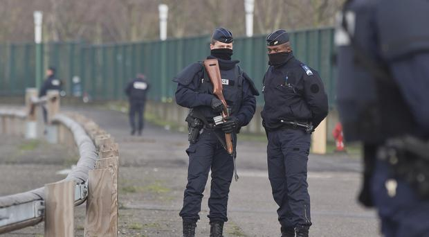 Bernard Cazeneuve said that nearly 15,000 police, gendarmes and customs officials are manning France's borders (AP)