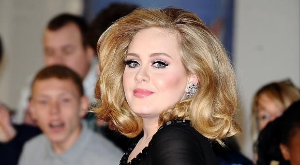 Adele's latest album has broken sales records in the US