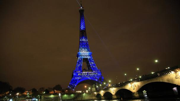An artwork is displayed on the Eiffel Tower ahead of the 2015 Paris Climate Conference (AP)