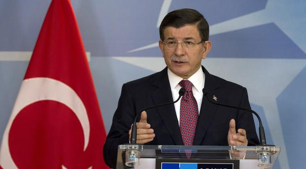 Ahmet Davutoglu denied claims by Russia that Turkey is purchasing oil from Islamic State (AP)