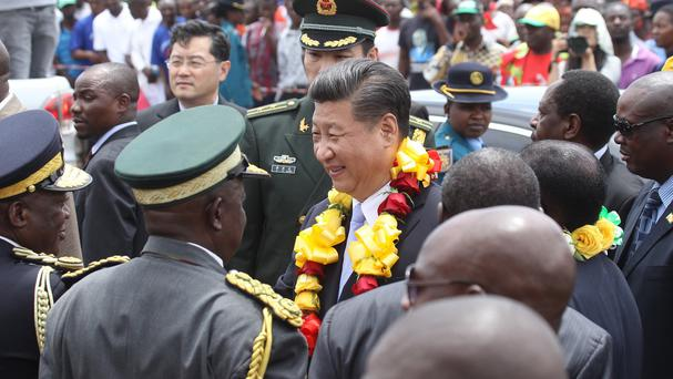 Chinese president Xi Jinping is welcomed upon his arrival in Harare, Zimbabwe (AP)