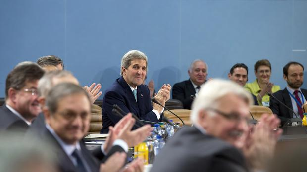 US Secretary of State John Kerry and other Nato foreign ministers during a meeting at Nato headquarters in Brussels (AP)
