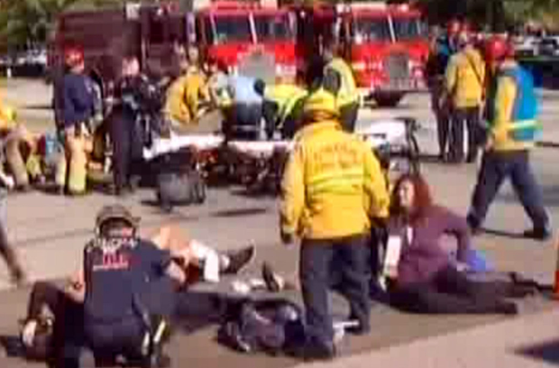 Emergency services tend to some of the wounded following the shooting