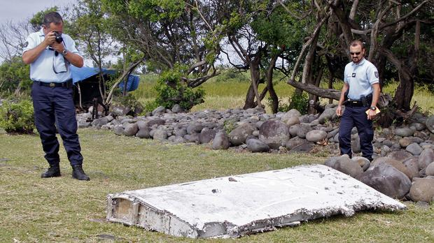 French police inspect debris in Saint-Andre, Reunion Island, which turned out to be a wing part from missing Malaysia Airlines Flight 370 (AP)