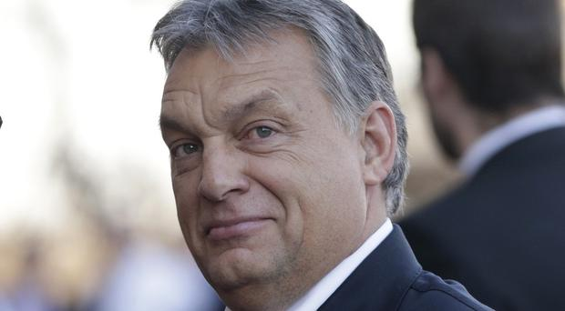 Viktor Orban said the suit would be filed at the European Court of Justice (AP)