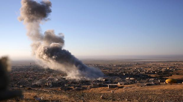 Smoke from a coalition air strike billows over the northern Iraqi town of Sinjar (AP)