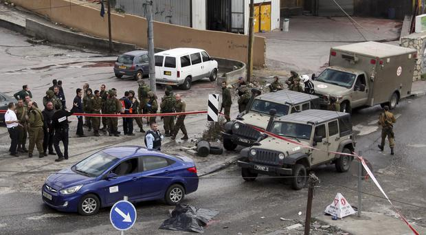 The scene of another stabbing attack in the West Bank (AP)