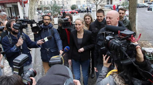 Far right National Front party regional leader for southeastern France, Marion Marechal-Le Pen speaks with media after casting her ballot (AP)