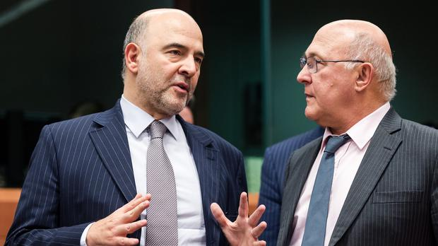 Michel Sapin, right, with European commissioner for economic and financial affairs Pierre Moscovici (AP)