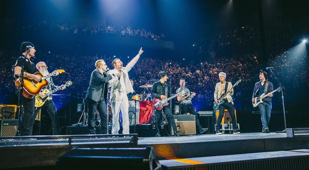 U2 and Eagles Of Death Metal on stage in Paris