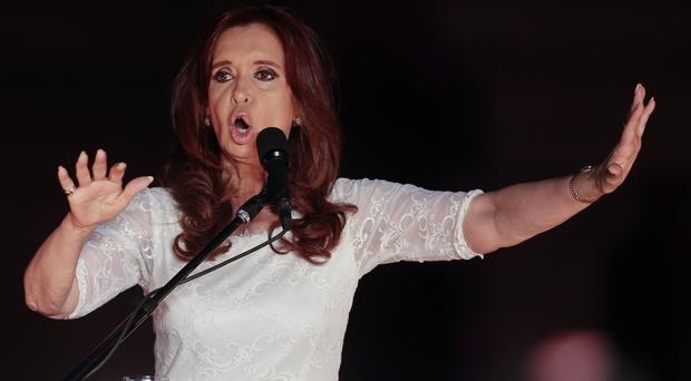 Argentina's President Cristina Fernandez de Kirchner talks to supporters at Plaza de Mayo square in Buenos Aires (AP)