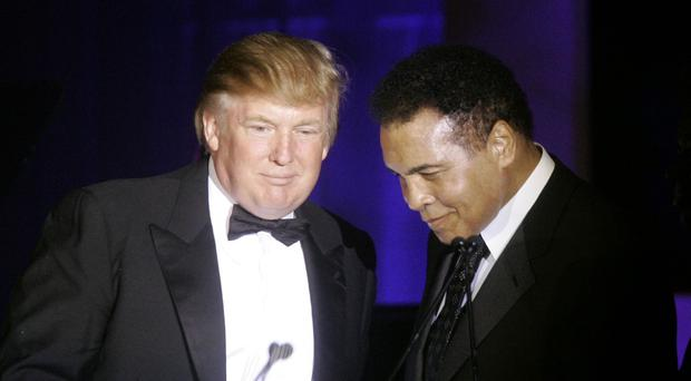Donald Trump accepts his Muhammad Ali award from the boxing great in 2007 (AP)