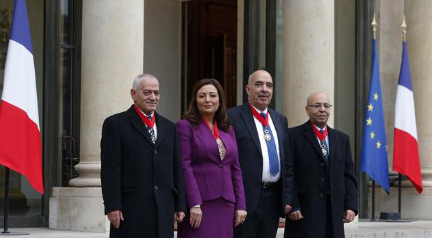 The four Nobel Peace Prize winners, from left, Houcine Abassi, Wided Bouchamaoui Abdessattar, Ben Moussa and Mohamed Fadhel Mafoudh. (AP)