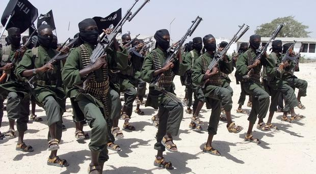 Al-Shabab fighters perform military exercises in the Lafofe area of Somalia (AP)
