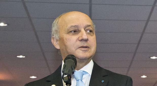 France's foreign minister Laurent Fabius is expected to present a potentially final draft of a climate deal on Saturday morning