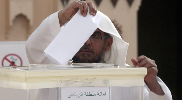 A Saudi man casts his vote at a polling centre in Riyadh (AP)