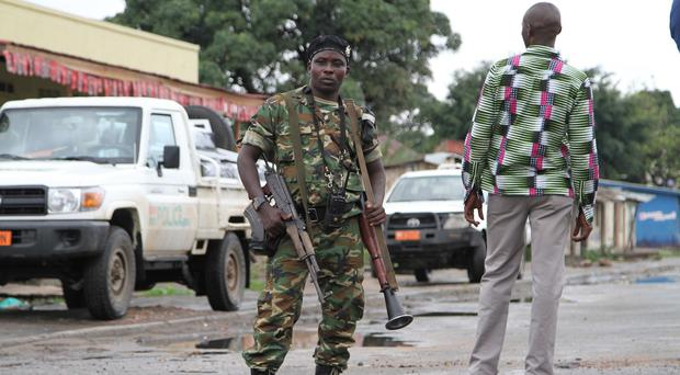 A Burundian soldier patrols the streets of the capital Bujumbura (AP)