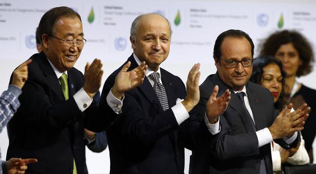UN secretary-general Ban Ki-moon, French president Francois Hollande and foreign Minister Laurent Fabius applaud after the final conference (AP)