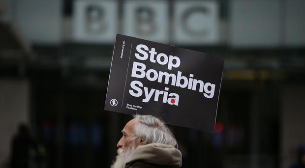 A protester at a Stop the War Coalition demonstration outside BBC Broadcasting House in London