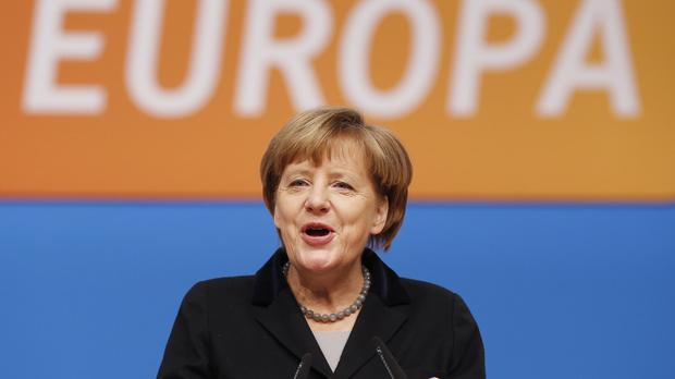 German Chancellor Angela Merkel speaks during a party convention of the Christian Democrats in Karlsruhe, Germany