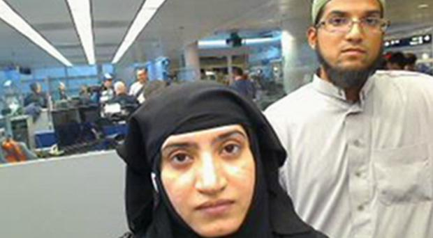 Tashfeen Malik and Syed Farook pictured passing through O'Hare International Airport in Chicago in July last year (US Customs and Border Protection/AP)