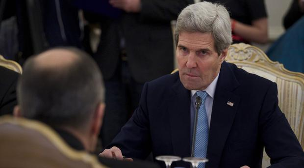 US secretary of state John Kerry listens to Russian foreign minister Sergey Lavrov during their meeting in Moscow (AP)