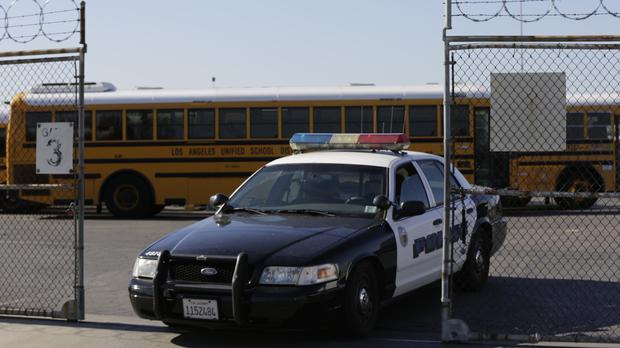 Los Angeles School District police patrol a bus garage in Gardena, California, after threats of a large-scale attack (AP)
