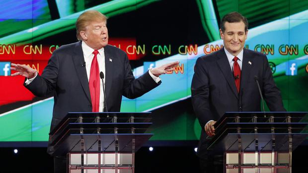 Donald Trump, left, in full flow as Ted Cruz looks on during the Republican presidential debate in Las Vegas (AP)