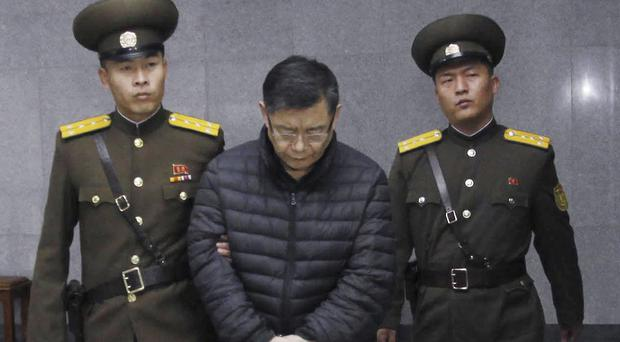 Hyeon Soo Lim is escorted to court in Pyongyang (AP)