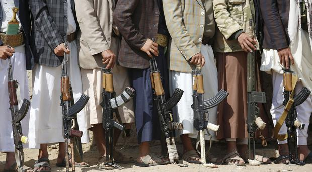 Shiite tribesmen, known as Houthis, hold their weapons during a tribal gathering showing support for the Houthi movement in Sanaa, Yemen (AP)