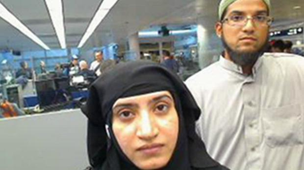 Tashfeen Malik and Syed Farook shown at O'Hare International Airport in Chicago last year (US Customs and Border Protection/AP)