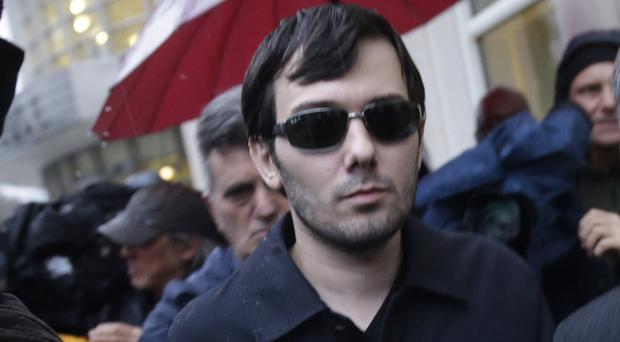 Martin Shkreli leaves court after his arraignment in New York (AP)