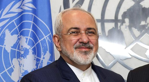 Iranian foreign minister Mohammad Javad Zarif says two key issues in the United Nations' Syria talks appear to remain without agreement (The United Nations/AP)