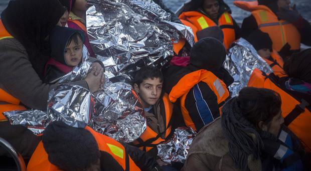 Refugees and migrants arrive on the Greek island of Lesbos after being rescued from the Aegean (AP)