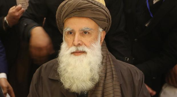 Former Afghan warlord Abdul Rasool Sayyaf at the inauguration of the Afghanistan Protection and Stability Council in Kabul (AP)