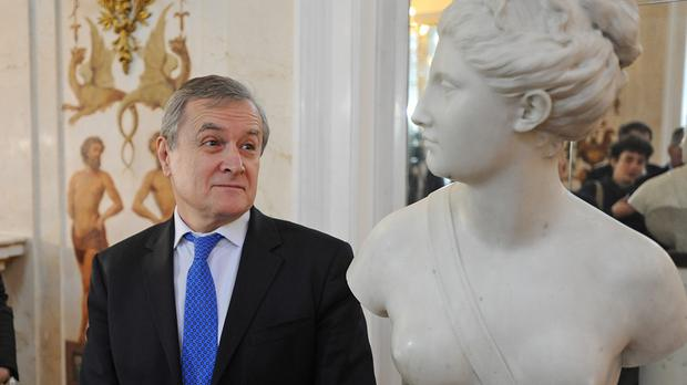 Poland's culture minister Piotr Glinski admires the marble bust of goddess Diana (AP)